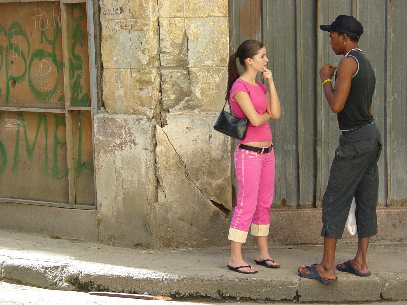 young_woman_and_man_on_the_street_-_centro_habana_-_havana_-_cuba